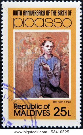 stamp printed in Malldives Islands shows boy with a pipe by Pablo Ruiz Picasso