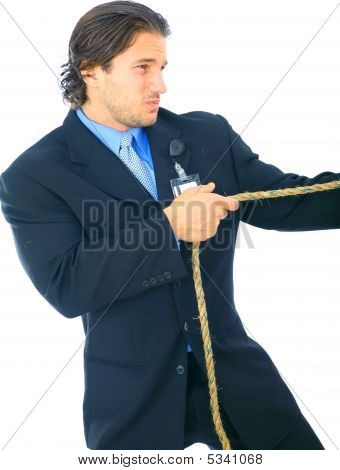 Struggling Businessman Pulling Rope