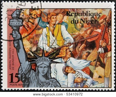 stamp printed in Niger shows Statue of Liberty and Joseph Warren martyr of Bunker Hill