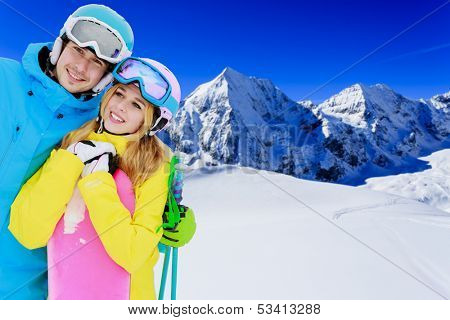 Skiing, snowboarding, winter sports - portrait of young skiers, couple having fun on ski