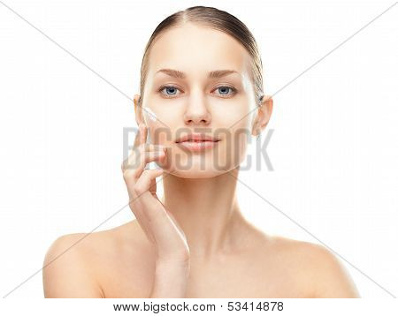 Young Woman With Cosmetic Cream On A Cheek