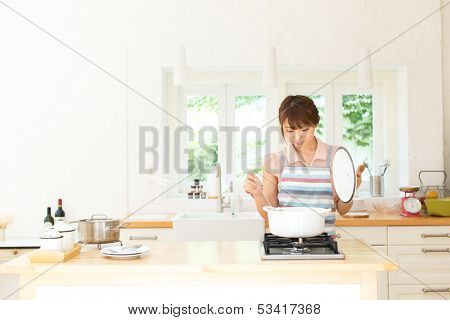 Beautiful young woman in the kitchen