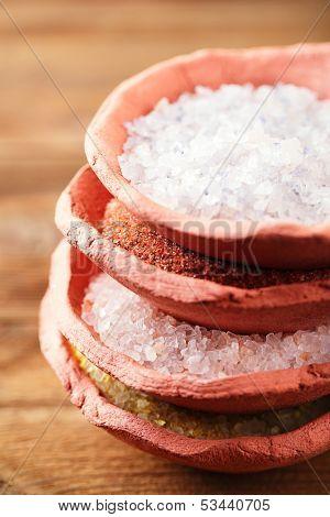 different type of salt in rustic clay bowls   stacked, Himalayan Pink Crystal Rock salt, Hawaiian Red Alaea Sea Salt, Persian Blue Iranian, Lemon Salt