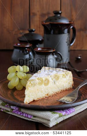 Pie with cheese and grapes