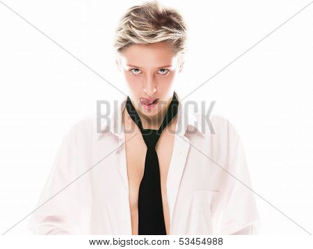 Young Blonde Woman Wearing A Tie Licking Her Lips