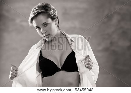 Young Blonde Woman Opening Her Button Down Shirt