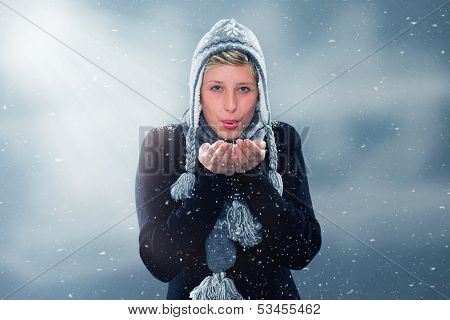 Young Woman Blowing Snow Off Her Hands