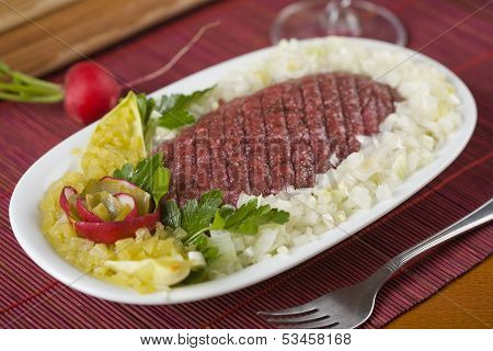 Traditional steak, made with raw mincemeat and eggs