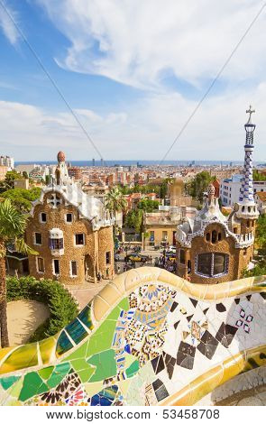 BARCELONA, SPAIN - SEPTEMBER 3: Park Guell main pavilions on September 5, 2012 in Barcelona, Spain. View on Barcelona and main entrance pavilions of Park Guell from the main terrace.