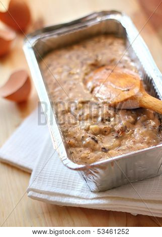 Mix Of Flour, Eggs, Bananas And Chopped Dark Chocolate And Walnuts In Aluminum Baking Tin
