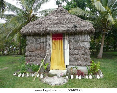 A Grass Sleeping Hut On Noumean Island Of Lifou.