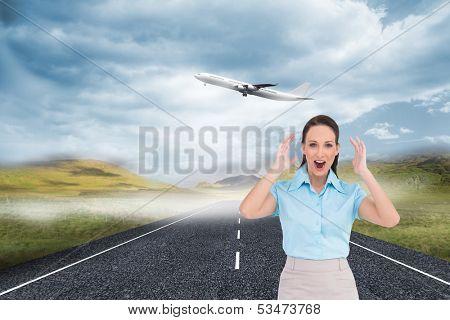 Composite image of surprised stylish businesswoman posing on white background