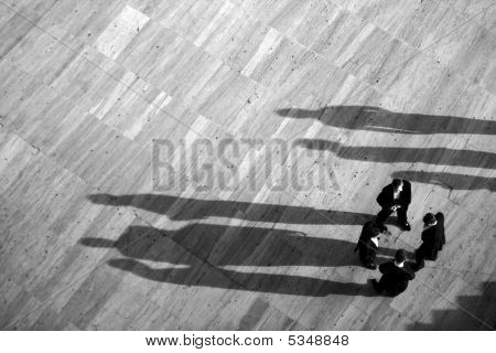 Group Of Men With Shadows