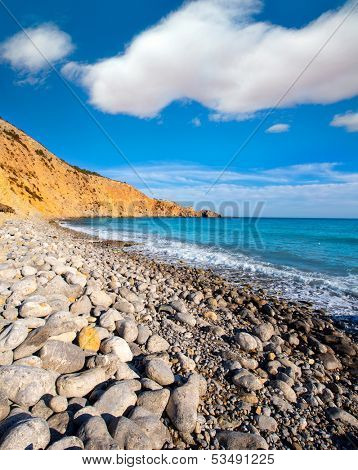 Ibiza Cala Jondal Beach with rolling stones in san Jose at Balearic Islands