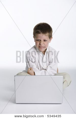 Angry Child With Laptop Computer