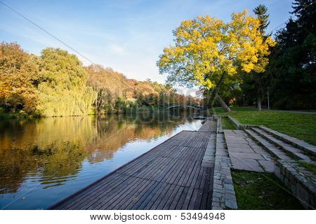 utumn Landscape. Park in Autumn. The bright colors of autumn in the park by the lake.
