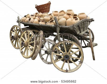 Old Wooden Cart Full Of Clay Pottery, Wheels And Wicker Basket Isolated Over White