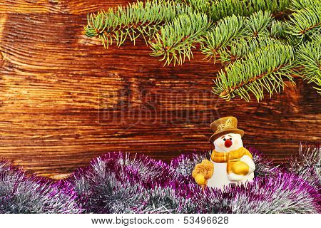 Christmas Decoration. Snowman, Tinsel And Fir-tree. Selective Focus