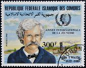 FEDERAL ISLAMIC REPUBLIC COMOROS - CIRCA 1985: A stamp printed in Comoros shows Mark Twain