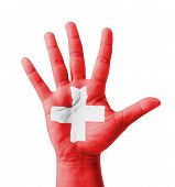 stock photo of multi purpose  - Open hand raised multi purpose concept Switzerland flag painted  - JPG