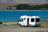 stock photo of motorhome  - Pure white motorhome parked at the lakes edge in Tekapo New Zealand - JPG