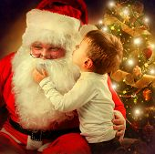 stock photo of in front  - Santa Claus and Little Boy - JPG