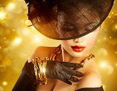 picture of vintage jewelry  - Glamour Woman Portrait over Holiday Gold Background - JPG
