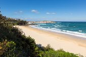 pic of st ives  - Porthminster beach St Ives Cornwall England with white waves and blue sea and sky on a beautiful summer day - JPG