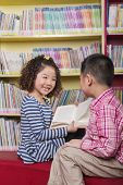stock photo of medium-  length hair  - Boy and girl reading together - JPG