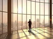picture of roof-light  - businessman speaking at sunset office - JPG