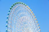stock photo of pubic  - Ferris wheel in blue sky from pubic park - JPG