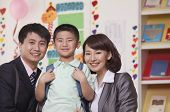 image of medium-  length hair  - Parents with their son in classroom - JPG