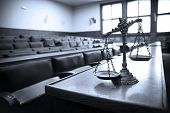 stock photo of justice law  - Symbol of law and justice in the empty courtroom law and justice concept blue tone - JPG