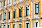 stock photo of neoclassical  - European style yellow building with green window Neoclassical architecture - JPG