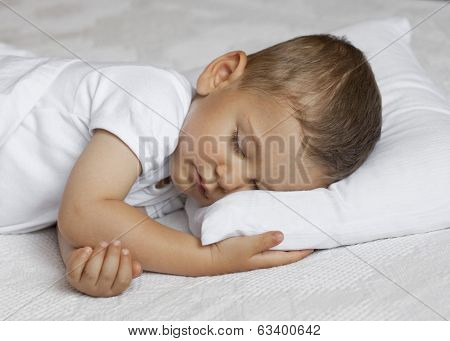 Cute child is sleeping in bed