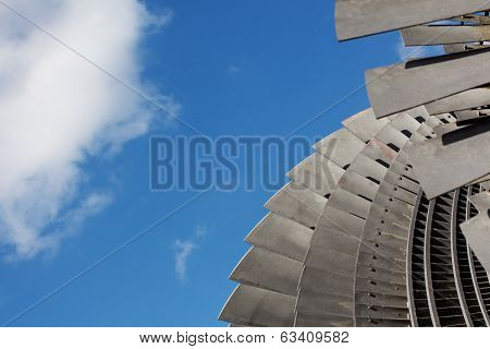 Detail Of Steam Turbine Against The Sky