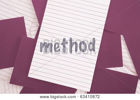 The word method against purple paper strewn over notepad