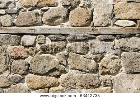 Wall Of Crushed Stone, Masonry And Wooden Plank