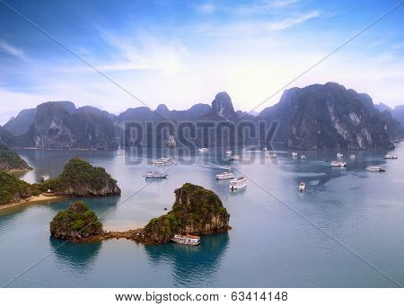 Halong Bay Vietnam panoramic view background. Mountains, islands and tourist boats on beautiful sea landscape