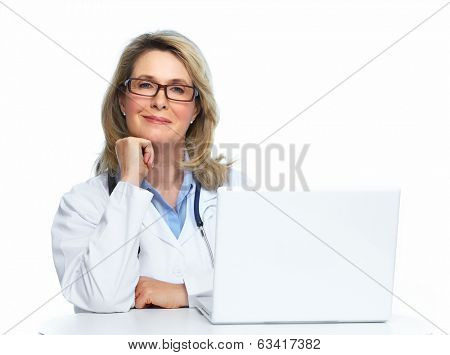 Doctor with laptop computer isolated on white background.