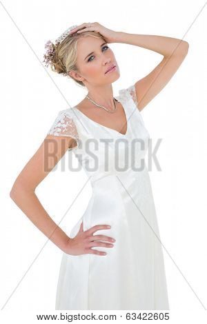 Portrait of sensuous bride posing against white background