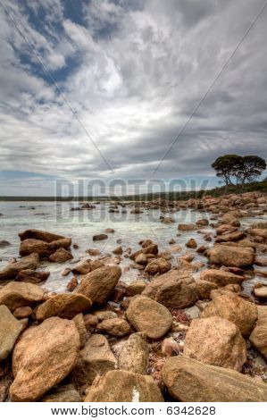 Rocky Bay With Dramatic Cloudscape