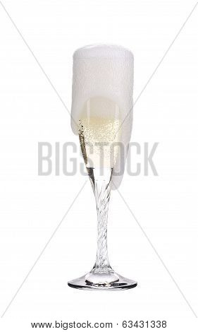Elegant full champagne glass. Trickles