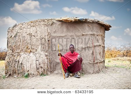 TANZANIA, AFRICA-FEBRUARY 9, 2014: Masai in front of traditional  hut, review of daily life of local people on February 9, 2014. Tanzania.