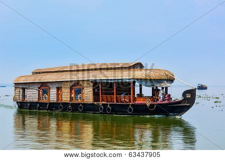 KERALA, INDIA - FEBRUARY 23, 2013: Houseboat on Kerala backwaters. Kerala backwaters are both major tourist attraction and integral part of local people life in Kerala