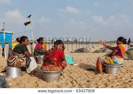CHENNAI, INDIA - FEBRUARY 10, 2013: Local Indian women on Marina beach in Chennai. Marina beach is the world's second longest urban beach.