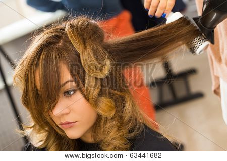 Hairdresser salon. Woman during haircut