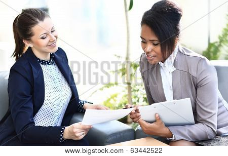 Businesswomen With documents and folder Sitting In