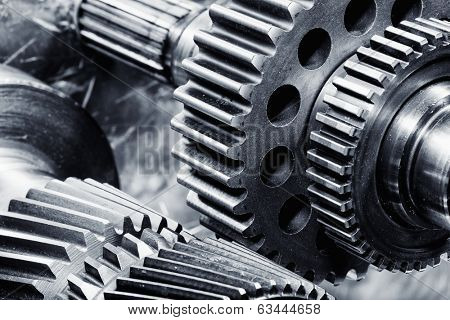 gears and cogwheels set against brushed aluminum, aerospace engineering