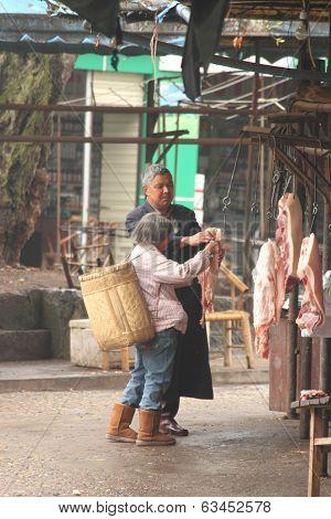 Local butcher in Luodai village Chengdu China